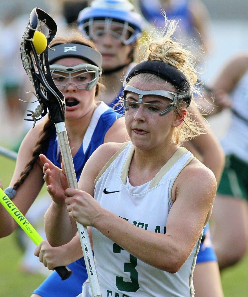 Fleming Island's Kierra Marquis keeps her stick close to her body while driving against Bolles